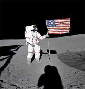 Astronaut Alan Shepard plants an American flag on the moon.